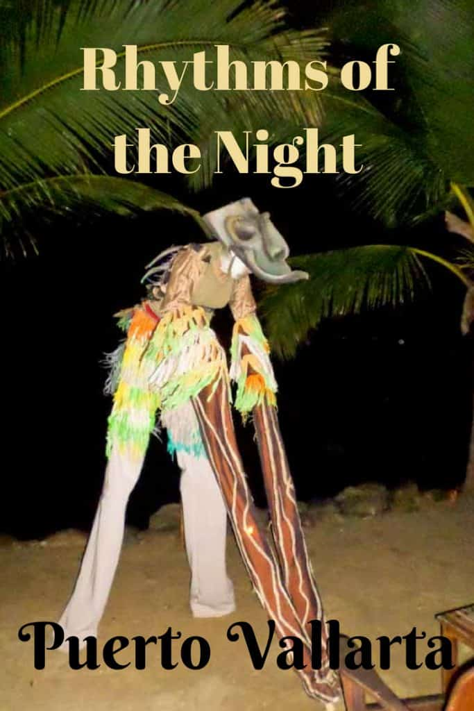 Performer on stilts and dressed as a pirate entertainson the beach at Rhythms of the Night Puerto Vallarta