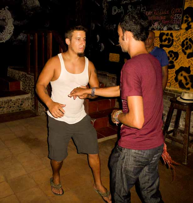 Nathan practicing his salsa moves with El Muro bartender and great dance instructor Omar