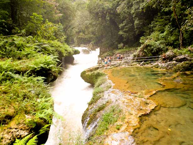 The raging river runs under the pools creating a natural limestone bridge at Semuc Champey