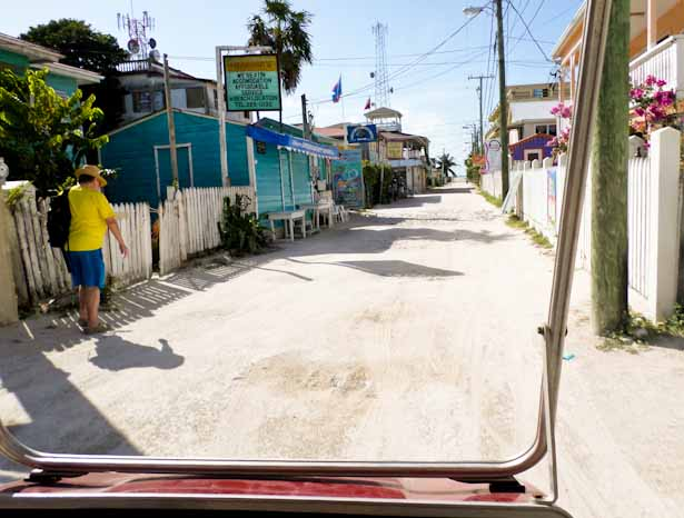 Driving our golf cart down Front Street, Caye Caulker, Belize on a budget