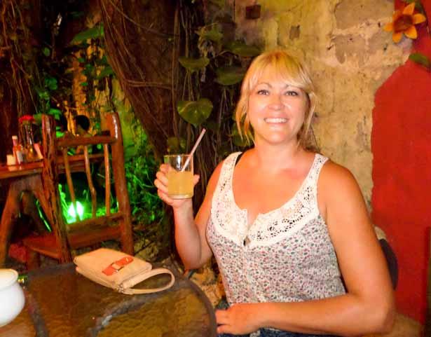 Indulging in a cold cocktail during Happy Hour at the Los Amigos bar, Guatemala Mayan Ruins