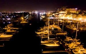 View of the boats lit up at night in Marina Vallarta