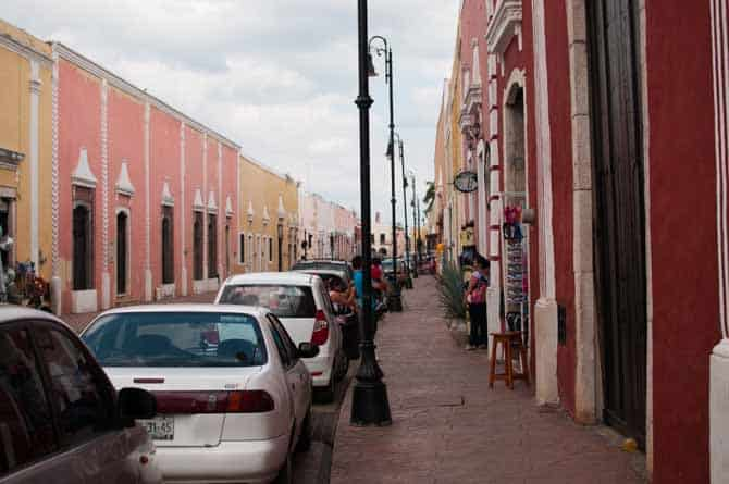 Street with pastel colored houses in Valladolid Mexico