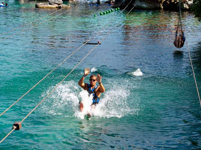 Nathan splashing down at the Xel Ha zipline water park yucatan