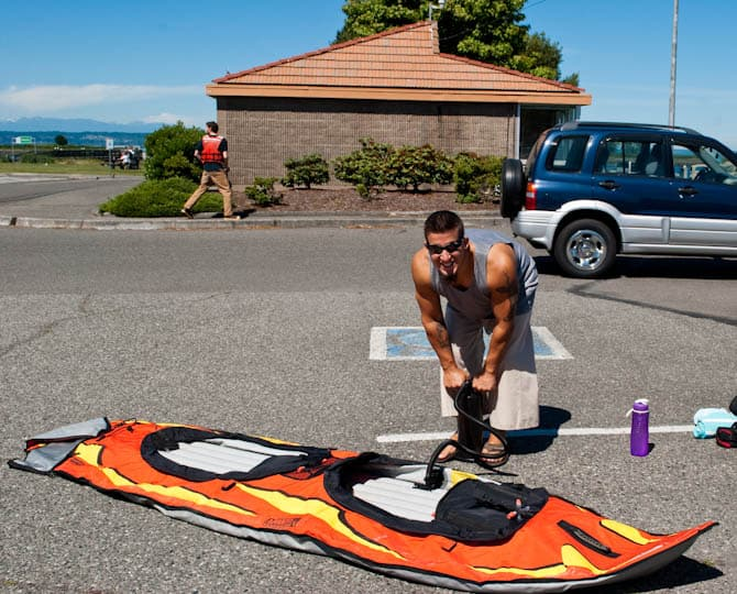 Nathan pumping up the inflatabale kayak for Jetty Island