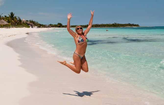Jumping in a bikini on the beach