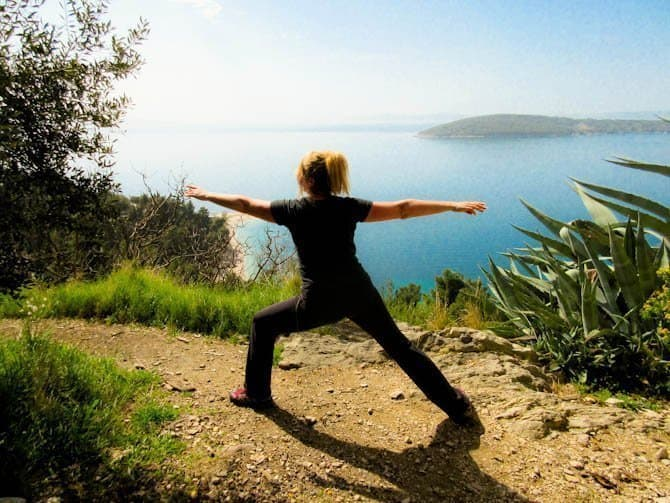 Doing Yoga on a cliff overlooking the sea in Split Croatia. One of many reasons we choose Split vs Dubrovnik.