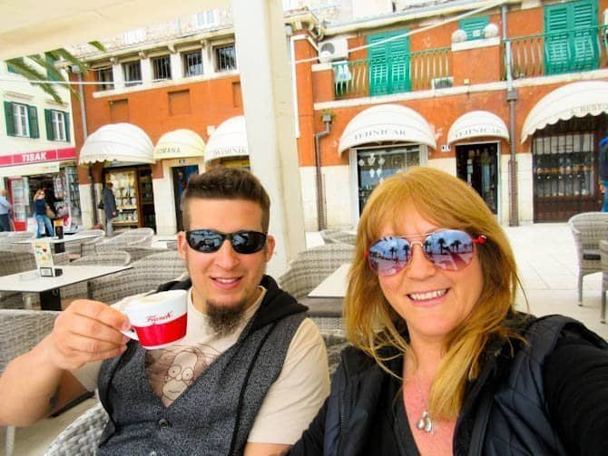 Sarah and Nathan enjoying a coffee in a cafe on the Riva in Split. Croatia