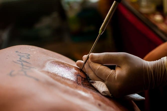 Sak Yant bamboo tattoo by a monk in Thailand