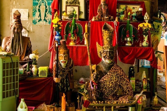 Statues in the Sak Yant bamboo tattoo parlor and shrine