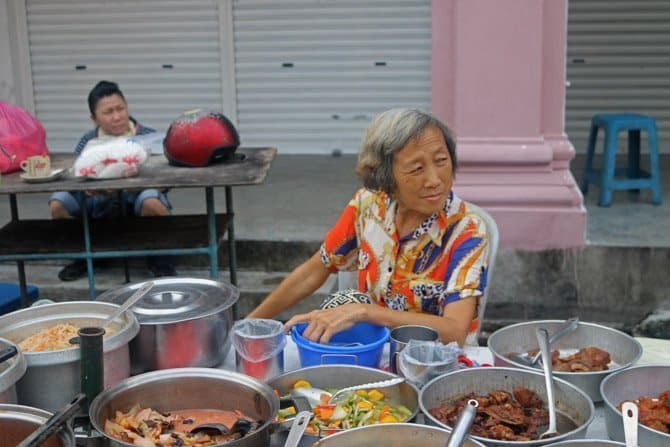 Where to go in Southeast Asia Malaysia stall-lady The Island Drum