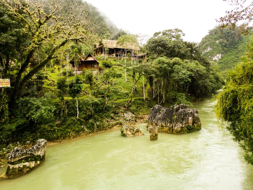 Beautiful scenery of the river, jungle and hostel cabins