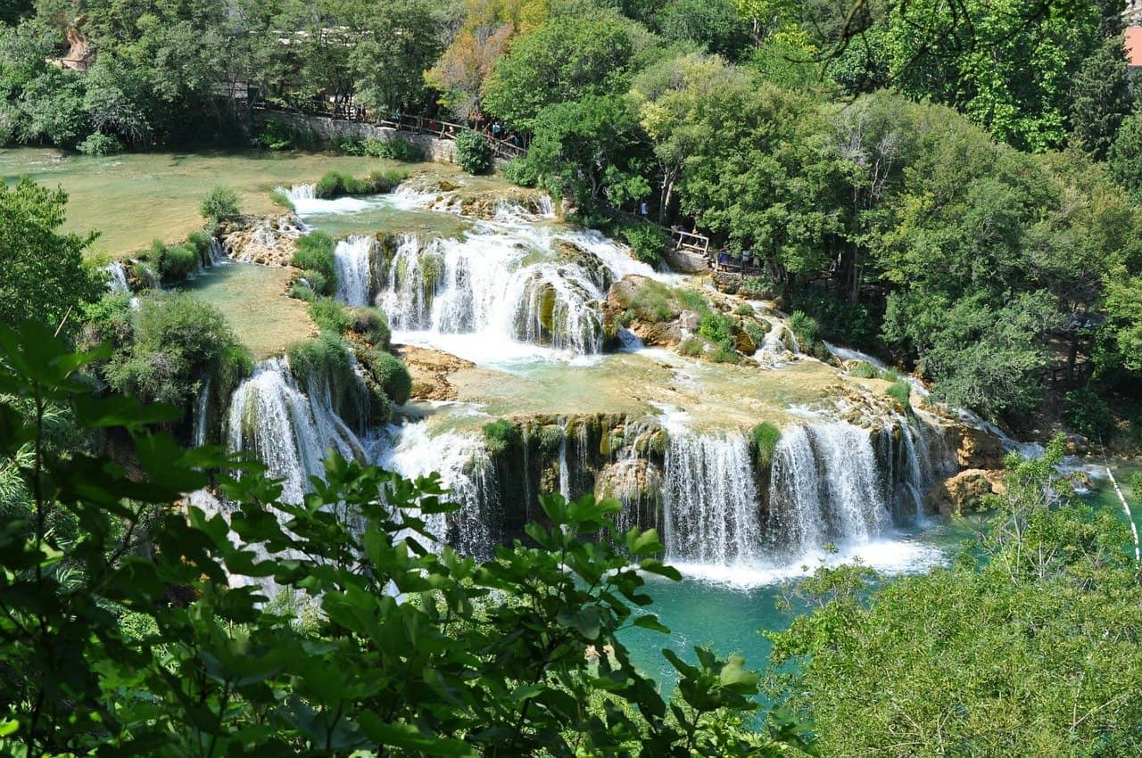 Stepped Krka waterfalls surrounded by greenery