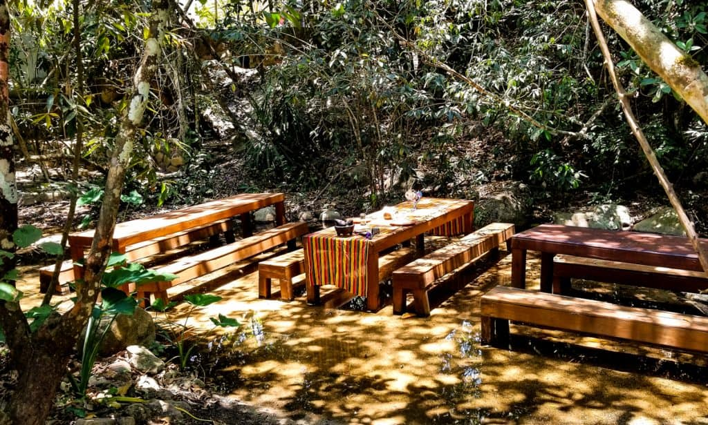 Picnic tables in a stream set with striped tablecloth