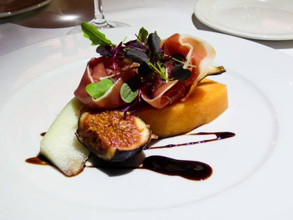 Prosciutto, melon and fig appetizer with a balsamic drizzle served at Aqua in Howth, Dublin