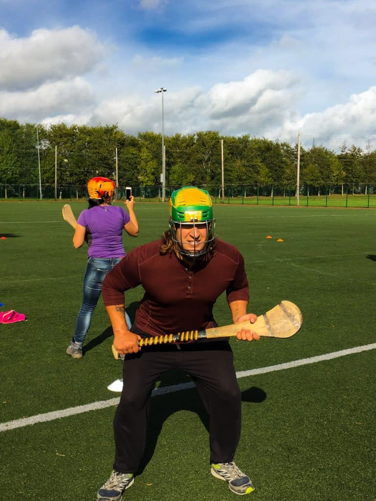 Nathan with his helmet on and bat in hand in a ready stance for Hurling at Clash Dublin