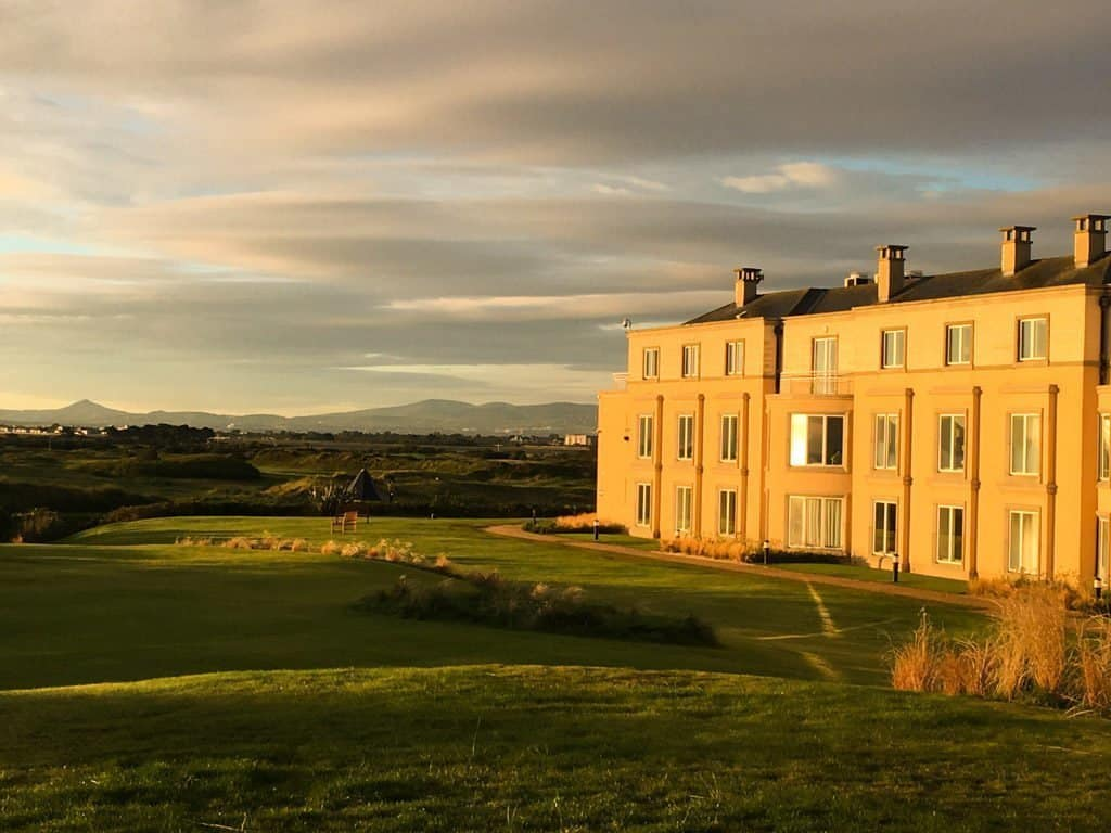 View of Portmarnock Hotel Dublin with the golf course and sand dunes in front
