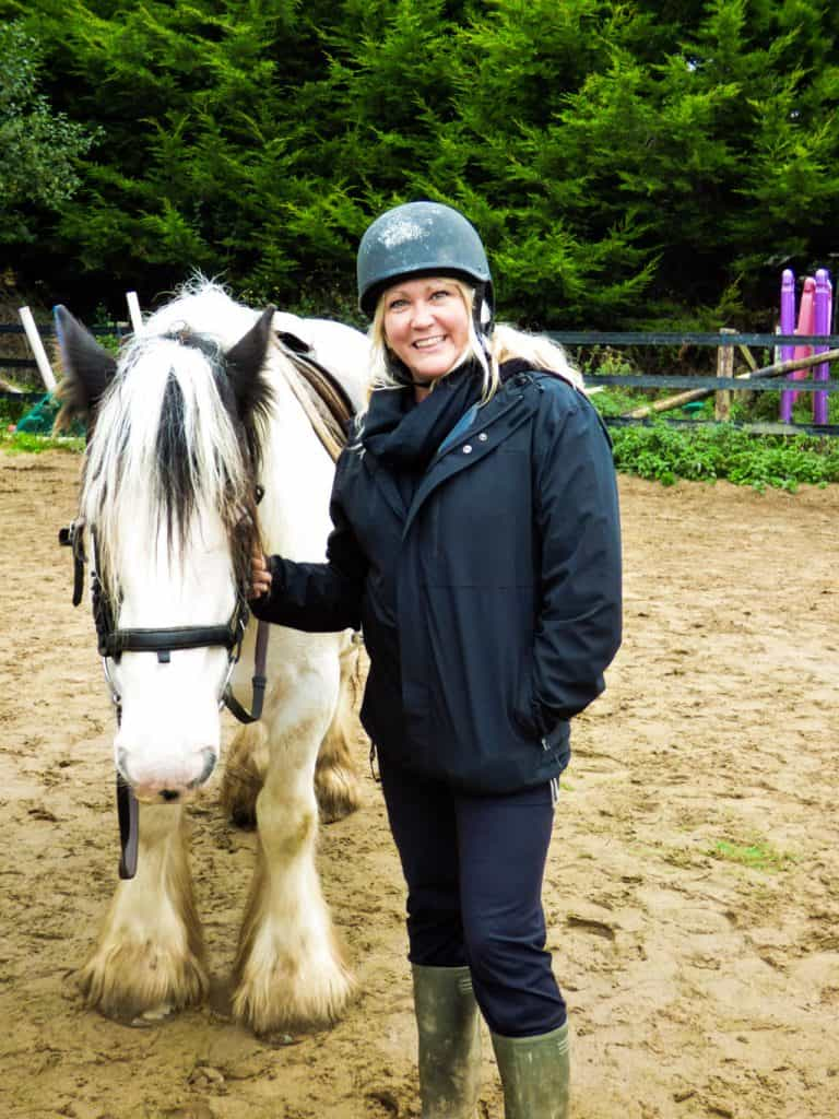Sarah & a white Clydesdale horse
