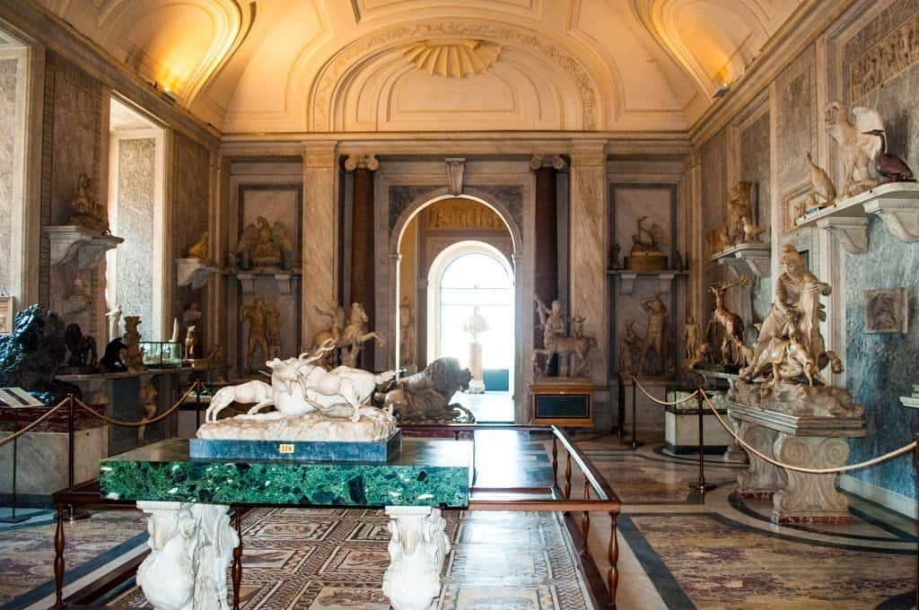 A room full of statues and priceless artwork in the Vatican Museum