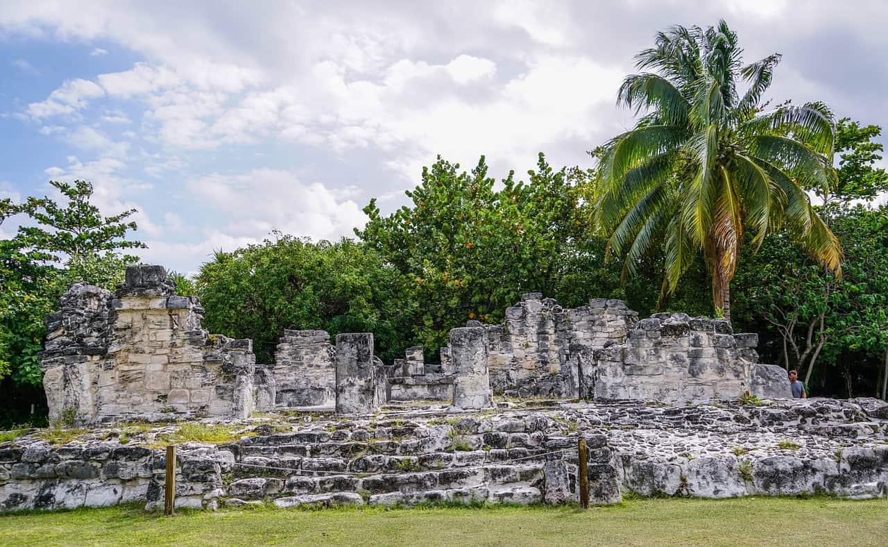 Stone Mayan ruins in jungle