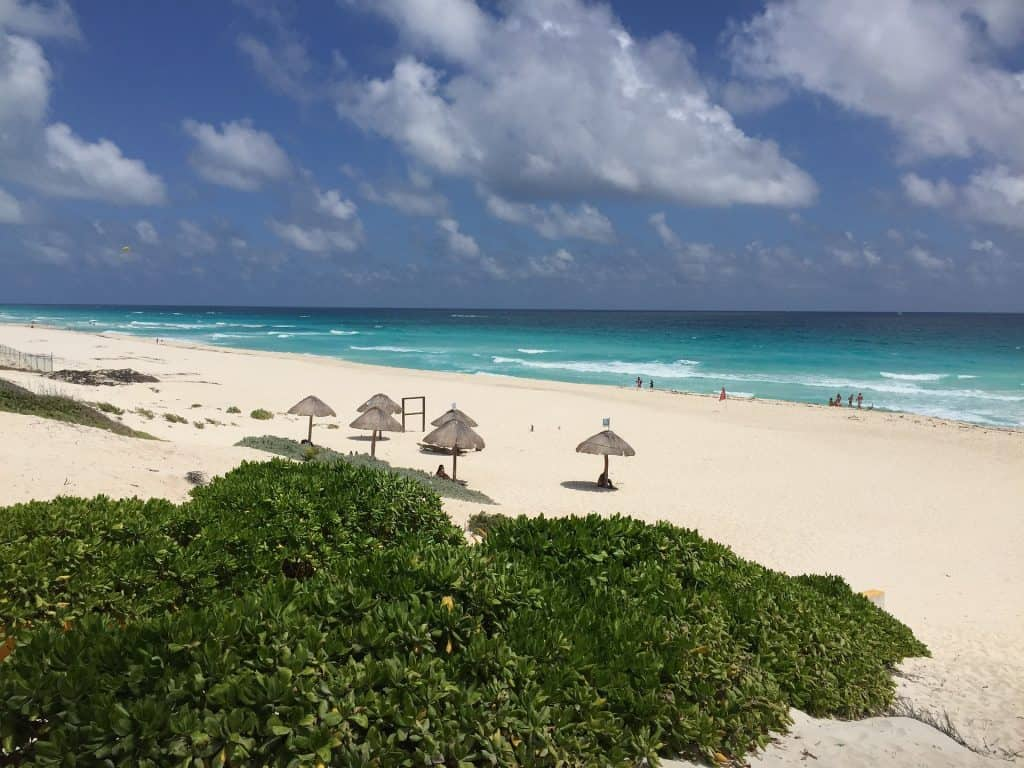 Playa Delfines Beach with thatch huts