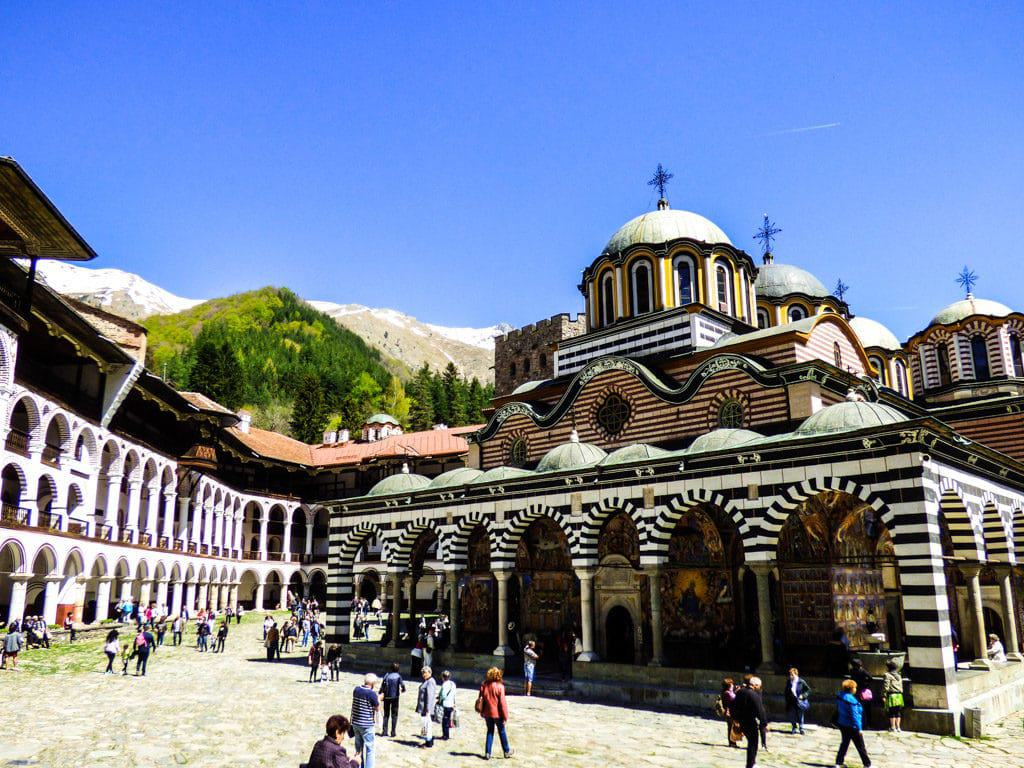 The beautiful Rila Monastery with a backdrop of snow capped mountain