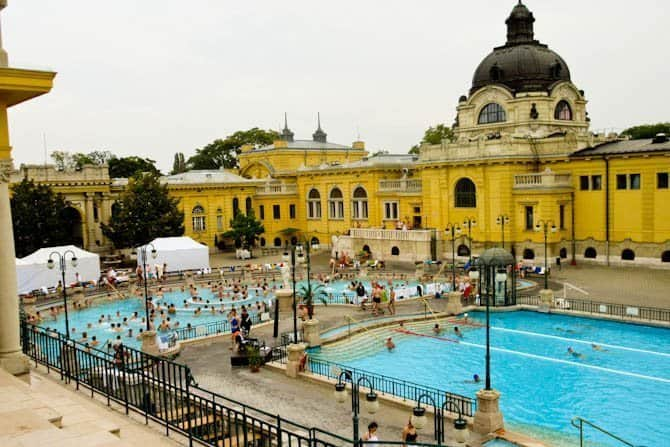 Pool and yellow builings at Szechenyi Baths Budapest