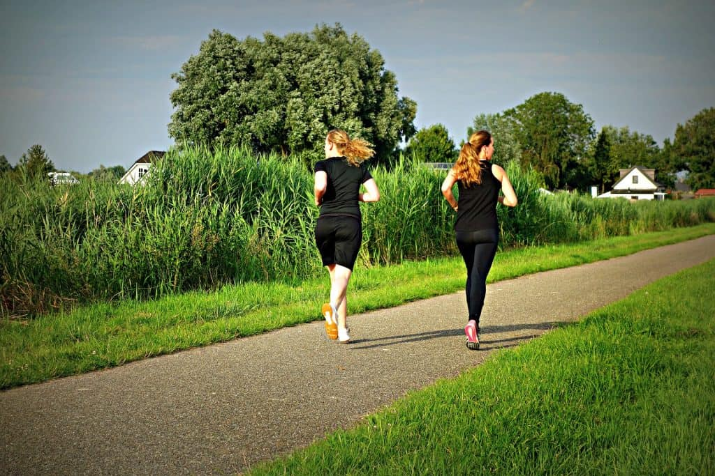 Two girls jogging in a park