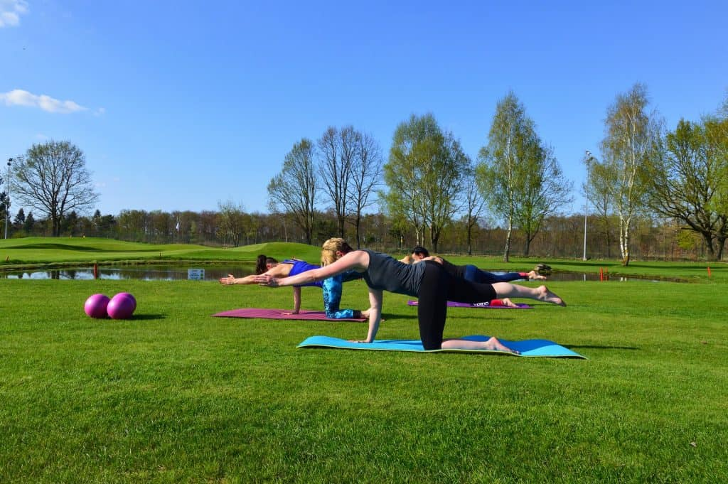Women doing Pilates in a park
