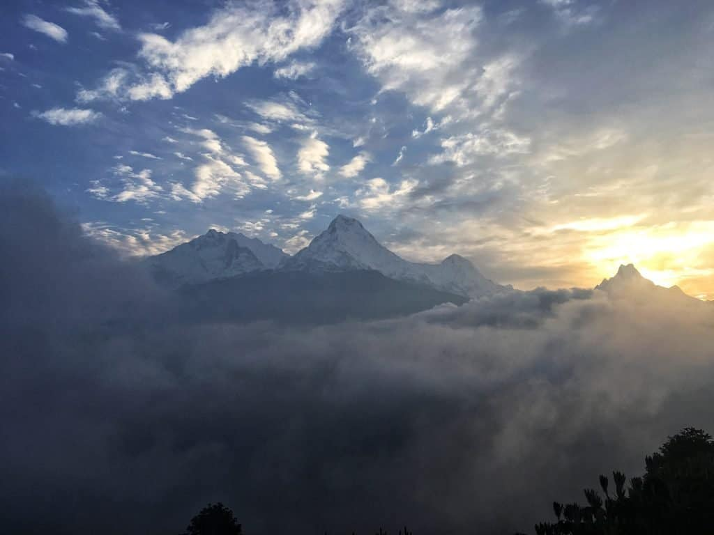 Image of Poon Hill Nepal with mist and low clouds