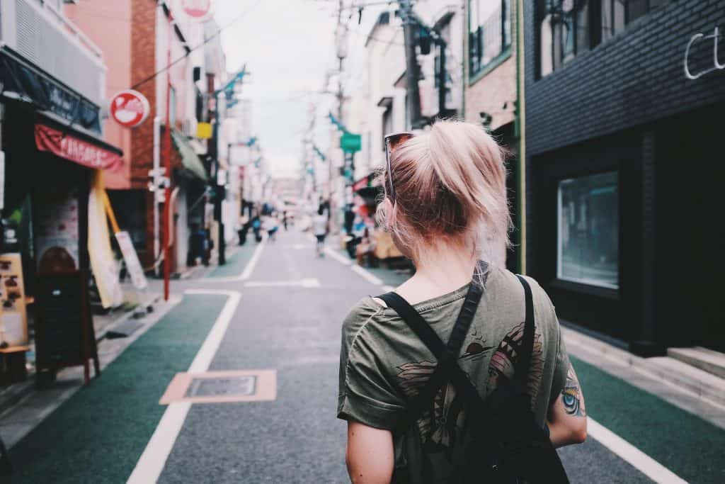 Back of a girl walking down a street