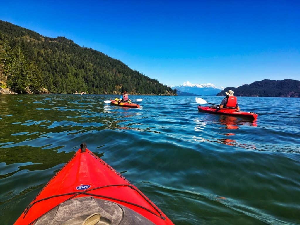 3 red kayaks on a lake: Things to do in Harrison Hot Springs