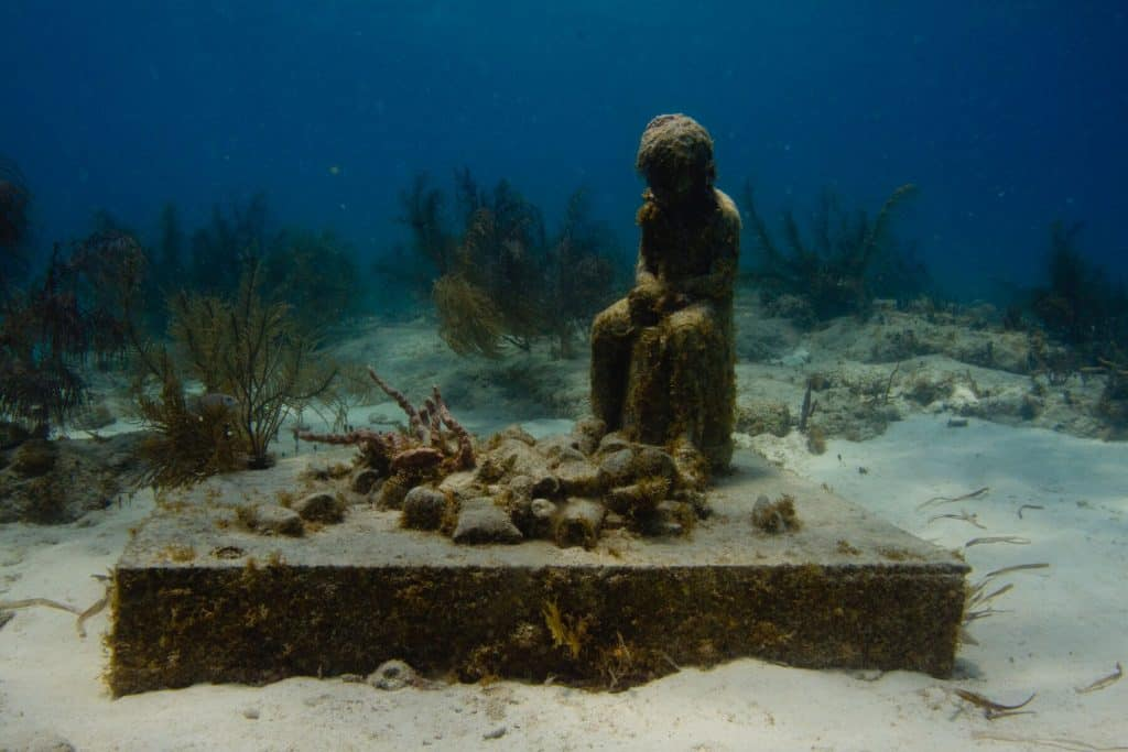 Inheritance Sculpture at MUSA Underwater Museum in Cancun Mexico