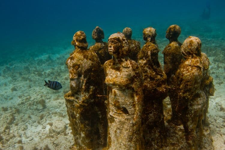 The Silent Evolution statues at teh MUSA Underwater Museum in Cancun