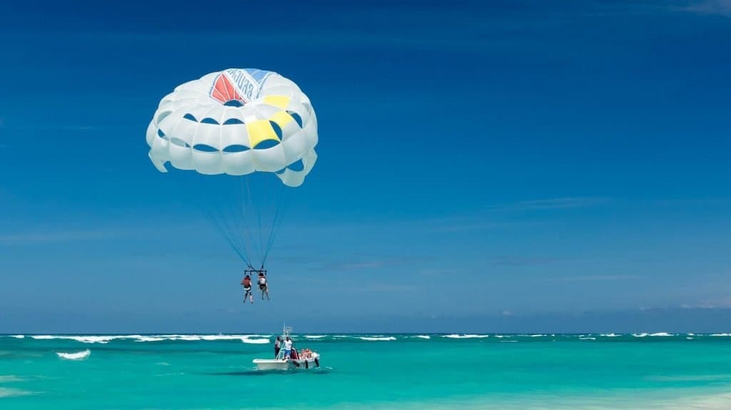 Parasailing over the turquoise waters of Playa del Carmen