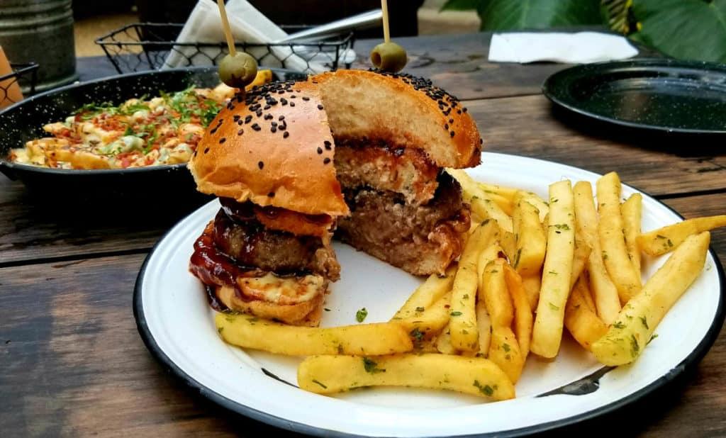 Burger with fries at Mu Burgerhouse Playa del Carmen