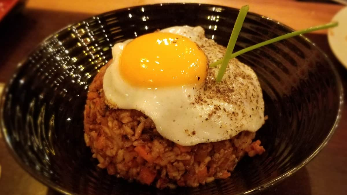 Bowl of fried rice with a fried egg on top