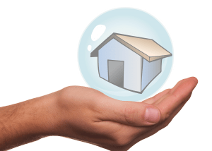 Home security: image of a hand holding a cartoon house