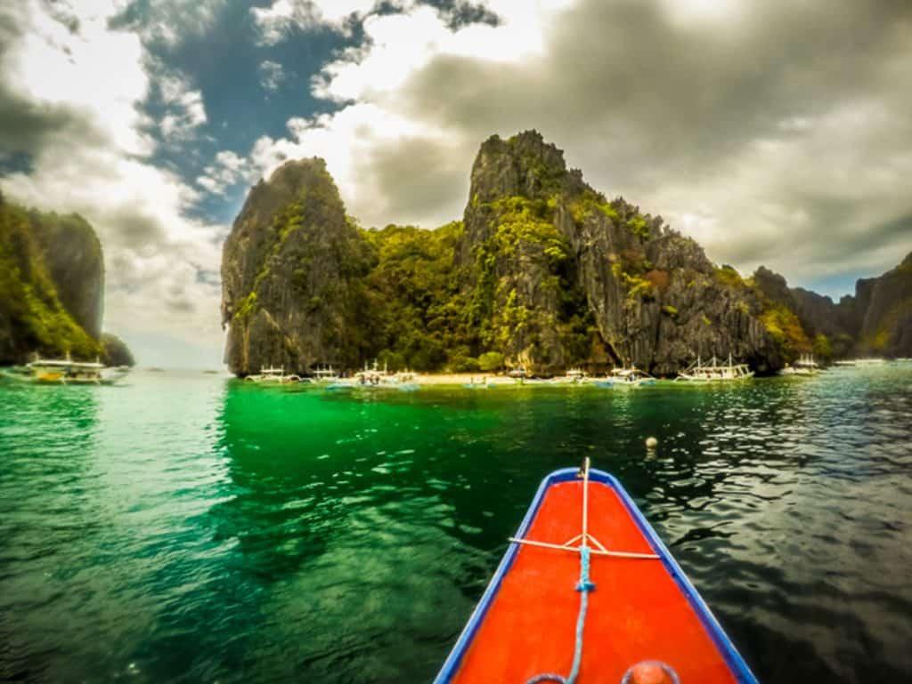 Kayak in the water approaching an island near Port Barton Palawan