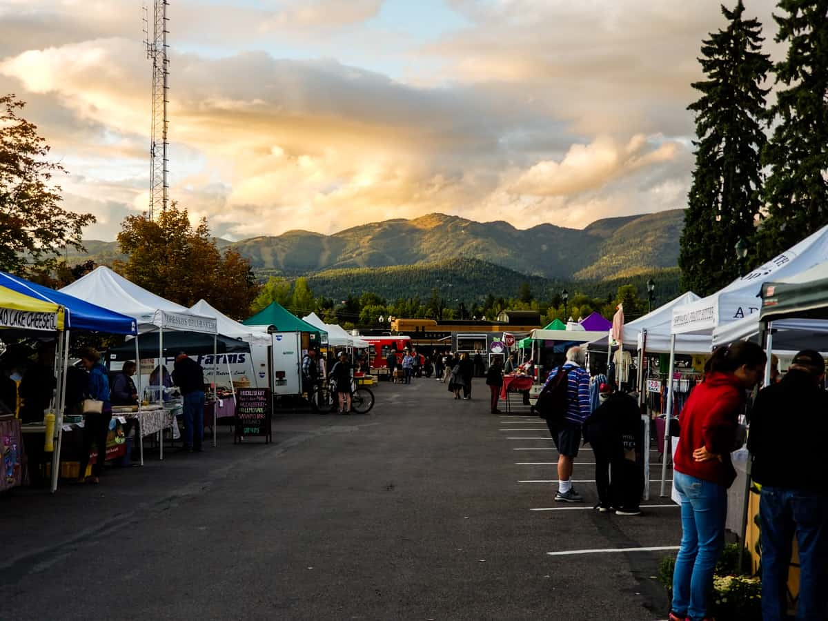 Farmer's market set up along a road with mountains in the background