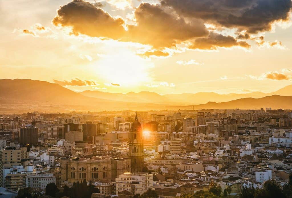 Golden sunset over the city of Malaga Spain