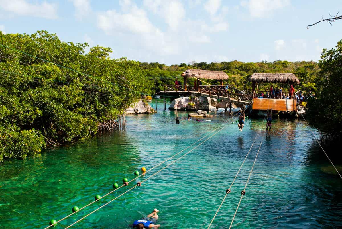 Ziplining over a lagoon in Xel-Ha Cancun