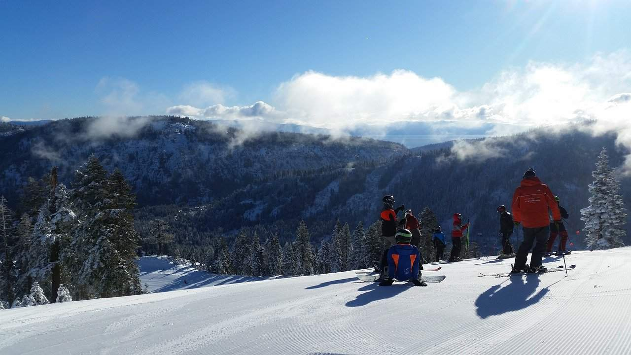 Skiers on a snowy mountain: Lake Tahoe Winter Activities