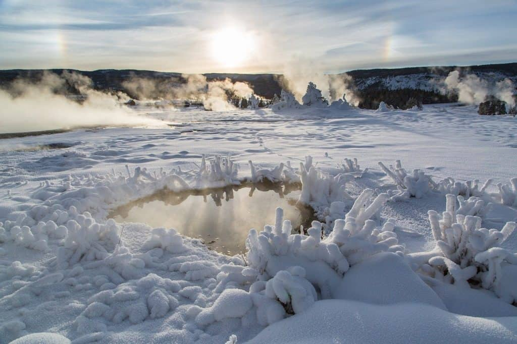 Frozen geothermal pools in Yellowstone in winter