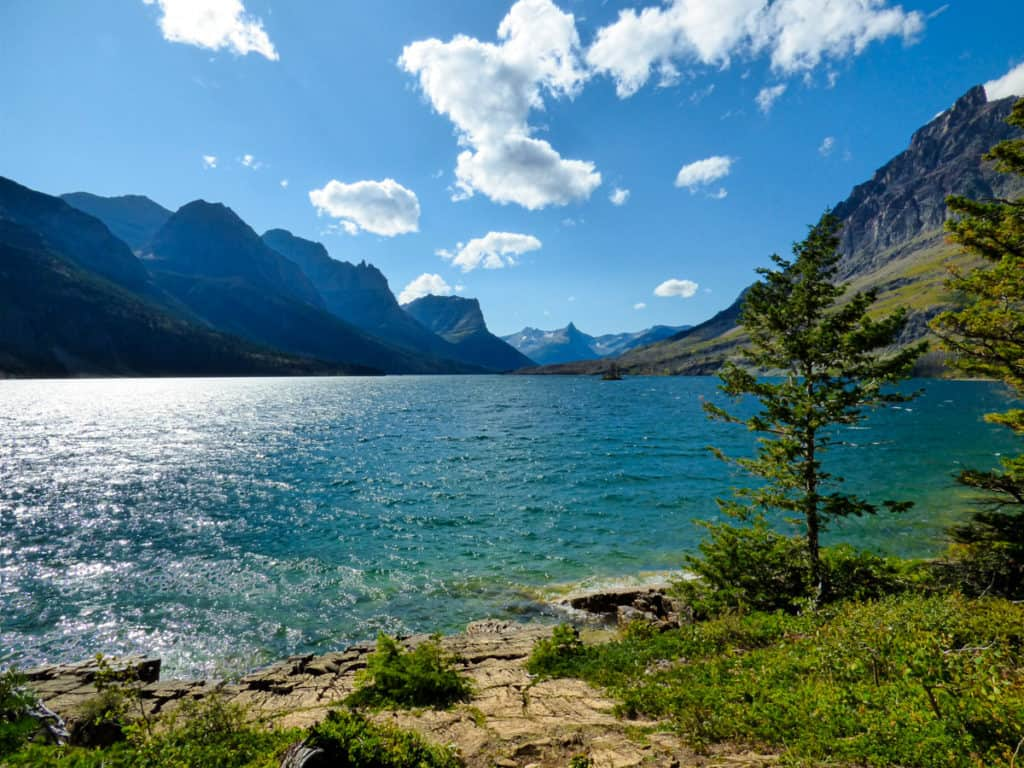Lake surrounded by mountains in Glacier National Park USA