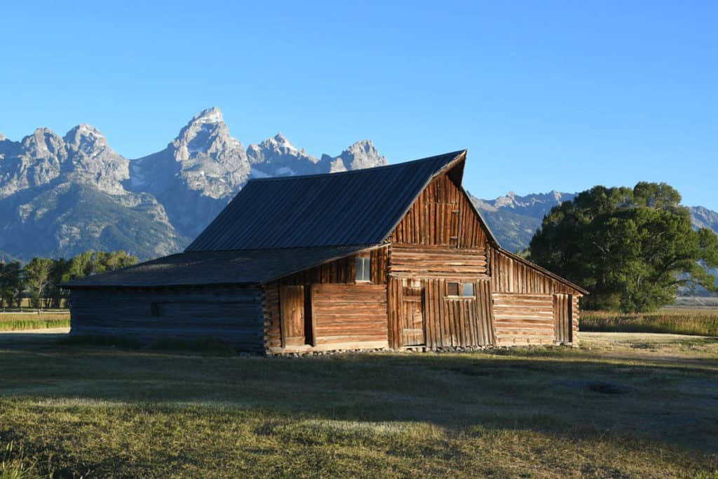 Old weathered barn with mountians behind in Grand Teton NP